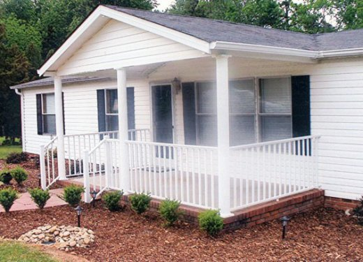 Gabled porch cover with white columns and handrails near Anderson, SC