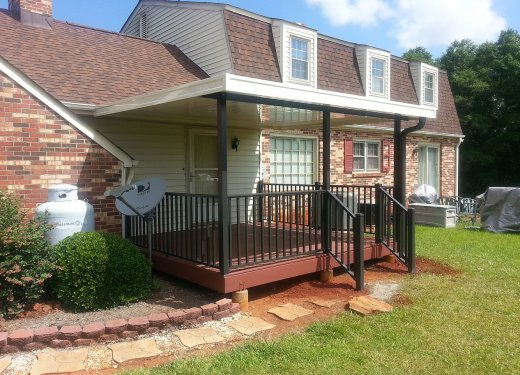 Ivory patio cover with bronze posts and rails near Simpsonville, SC